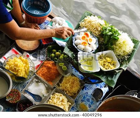 traditional floating market in Bangkok, Thailand - stock photo