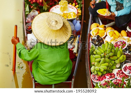 Traditional floating market in Damnoen Saduak near Bangkok - stock photo