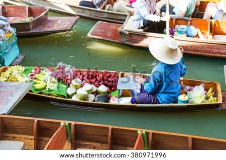 Traditional floating market in Damnoen Saduak near Bangkok. Thailand - stock photo