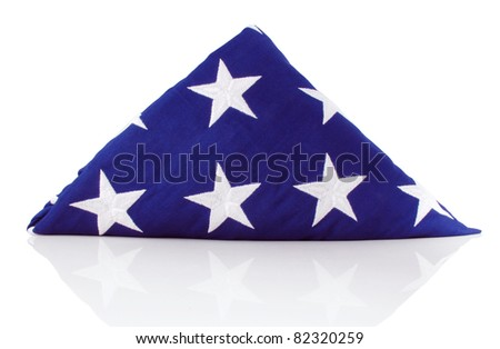 Traditional folded flag presented to the family of US veterans of the armed services - stock photo