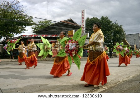 """Traditional folk-dancers in the """"Saulug de Tanjay"""" parade, in Negros Oriental, Philippines. - stock photo"""