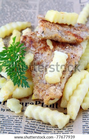 traditional food fish and chips on a wooden table - stock photo