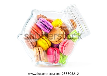 traditional french colorful macarons in a glass jar on white background - stock photo