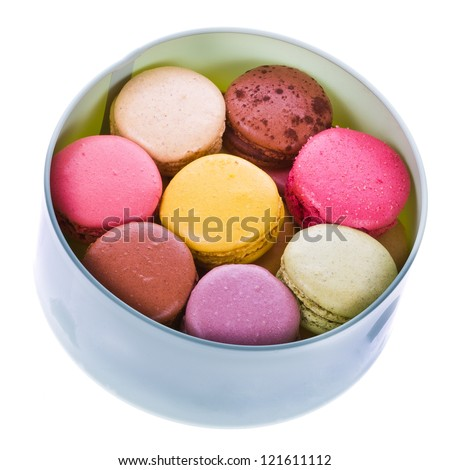 traditional french colorful macaroons put into a round cardboard box   isolated on white background - stock photo
