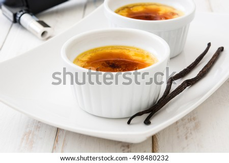 Traditional French creme brulee dessert with caramelized sugar on top, isolated on white background.