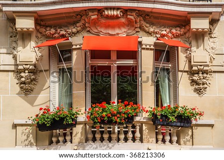 Traditional French house with typical balconies and windows. Paris, France. - stock photo