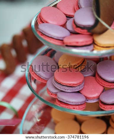 traditional french macarons on plate - stock photo