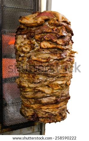 Traditional fresh Greek Gyros meat on a stick. Isolated on white background - stock photo