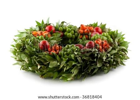 Traditional Fresh Holi Wreath, isolated on white - stock photo