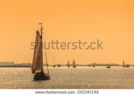 Traditional Frisian Dutch sailing ship during sundown - stock photo