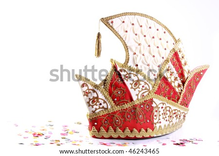 traditional german jesters hat and confetti on white background - stock photo