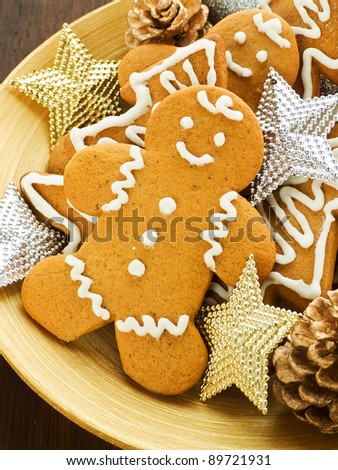 Traditional gingerbread cookies on the wooden plate. Shallow dof. - stock photo