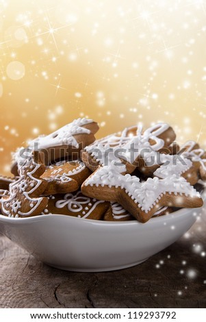 Traditional gingerbread cookies on wooden background - stock photo