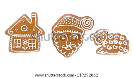 Traditional gingerbread cookies over white background - stock photo