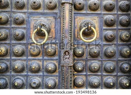 Traditional gold metal door - stock photo