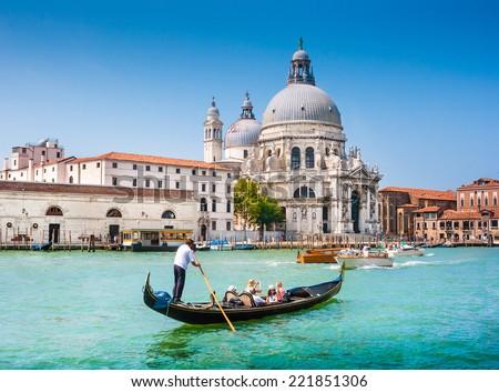 Traditional Gondola on Canal Grande with Basilica di Santa Maria della Salute in the background, Venice, Italy - stock photo