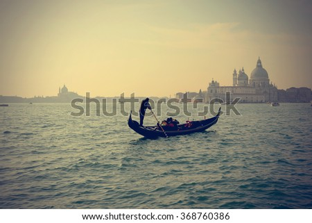 Traditional Gondola on Canal Grande with San Giorgio Maggiore church in the background in at sunset, San Marco, Venice, Italy (Filtered image processed vintage effect) - stock photo