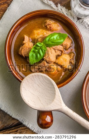 Traditional goulash soup with pork and dumplings.