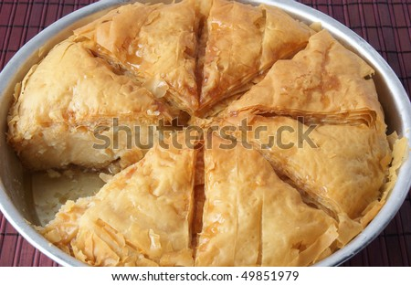 traditional Greek dessert cut into parts - stock photo