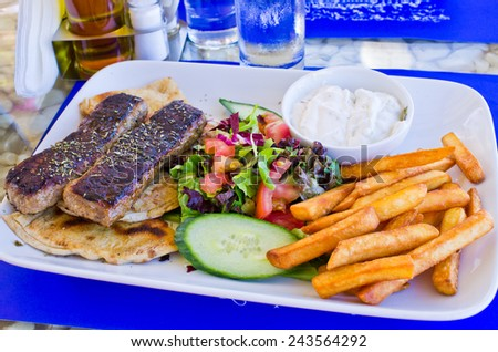 Traditional greek food on the plate - stock photo