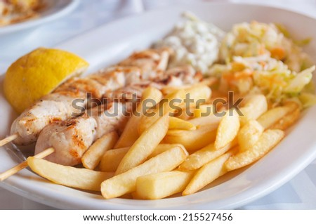 Traditional Greek food - Souvlaki with french fries - stock photo