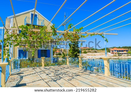 Traditional greek house with vine growing on terrace in Fiskardo village, Kefalonia island, Greece - stock photo