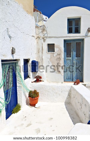 Traditional Greek houses at Oia village of Santorini island - stock photo
