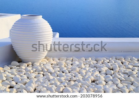 Traditional Greek pot painted white on the island of Santorini, Greece - stock photo