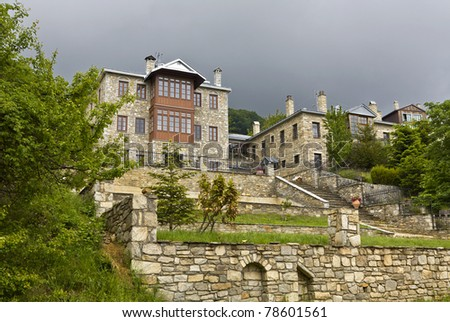 Traditional Greek stone made houses located at Nymfaio village - stock photo