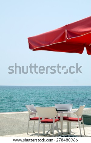 Traditional Greek table at the beach in Greece - stock photo