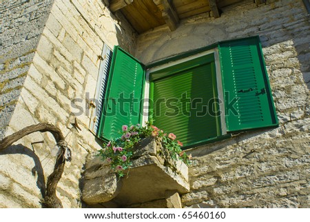 Traditional greek window with flowers in Epirus, north Greece - stock photo