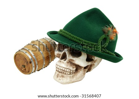 Traditional green felt German alpine hat with rope twists and bright feathers on a skull with an oak barrel nearby - path included - stock photo