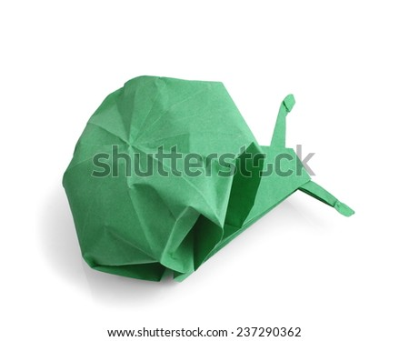 traditional green origami snail isolated on white background