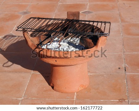 traditional grill on terrace of riad in Marrakesh