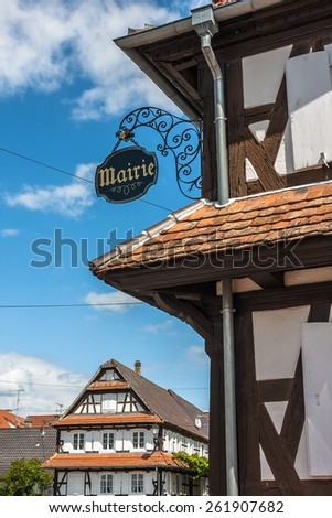 Traditional half-timbered houses in the streets of the small town of Hunspach in Alsace, France - stock photo