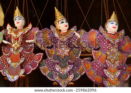 Traditional handicraft puppets are sold in a shop in Bagan, Myanmar - stock photo