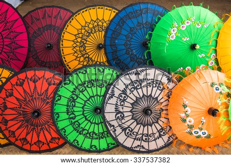 Traditional handicraft umbrellas are sold in a shop in Bagan, Myanmar - stock photo