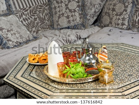 Traditional heavy Moroccan Sugar Cone or Qalib Sukar and tea tray with Ramadan cookies - sugar cones are gifts to mark the birth of babies, weddings or to pay condolences - stock photo