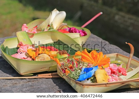 Traditional Hindu Offerings  to God, with Flowers and Incense or Aroma Stick in a Banana Leaf Basket. Local Balinese Style at Bali, Indonesia. - stock photo