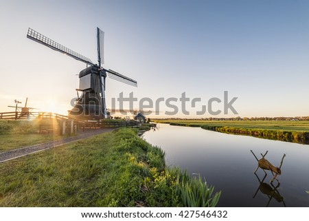 Traditional Holland landscape with windmills and canals, Kinderdijk - stock photo