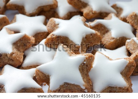 Traditional holliday homemade star-shaped sugar iced cookies - stock photo