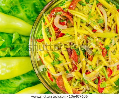 Traditional home made Thai mango fruit salad, locally known as Somtam. - stock photo