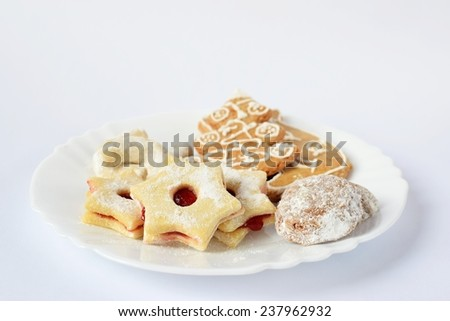 Traditional homemade Christmas cookies on a plate with a pure white background. - stock photo