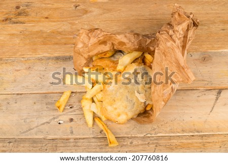 Traditional homemade fish and chips in a paper wrap - stock photo