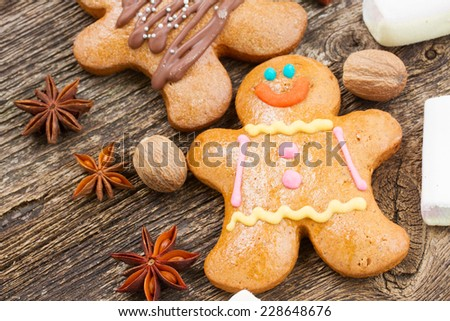 traditional homemade gingerbread man with spices on wooden table