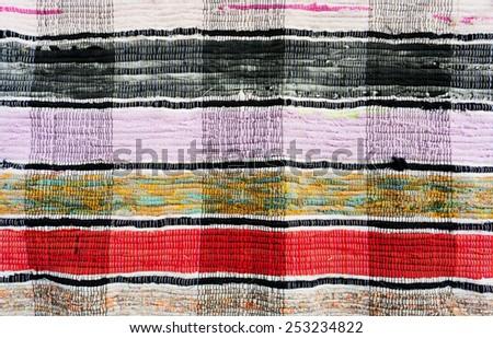 Traditional homespun carpet texture - stock photo