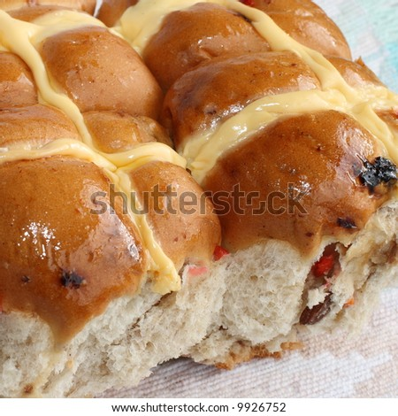 Traditional hot cross buns for Easter on a pastel cloth