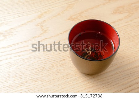 Traditional hot Japanese green tea on wood table with copy space for text