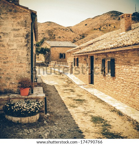 Traditional house from Perithia old village, Corfu - vintage coaster - stock photo