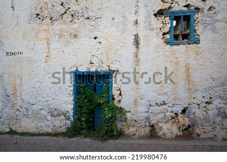 Traditional house in southern Crete with a sign 'for sale', Greece.